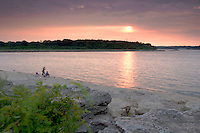 Fishermen Watching Sunset over Fossil Beds, The Falls of the Ohio State Park, Indiana