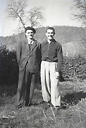 male buddies posing for an image out of focus countryside 1950s