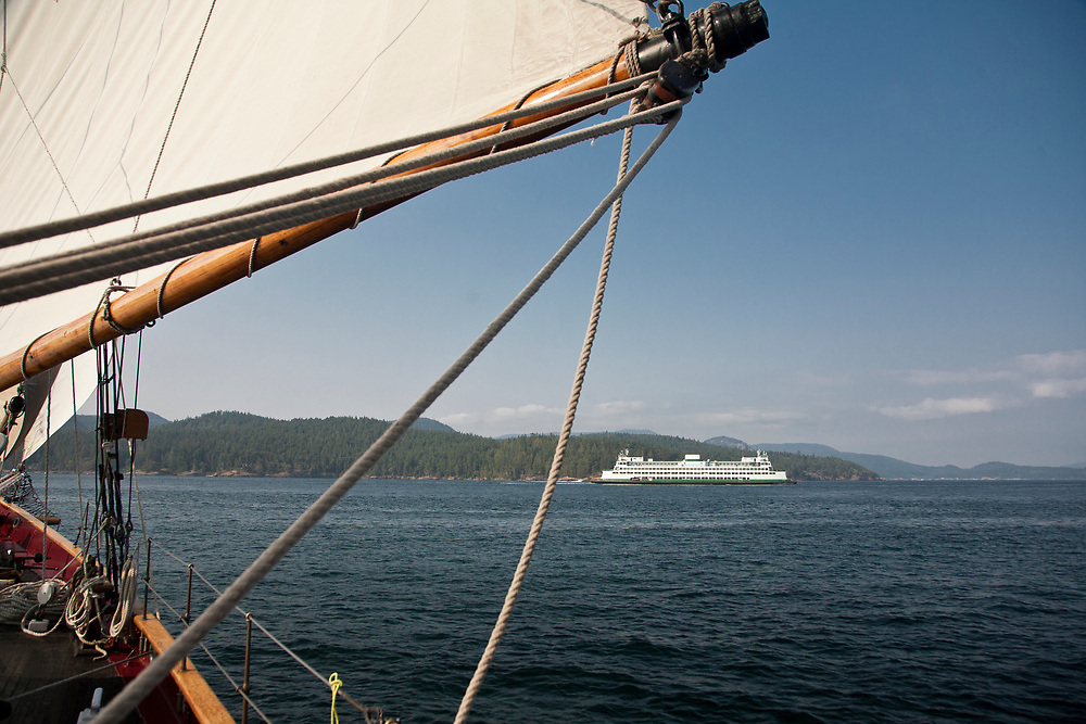 "United States, Washington, San Juan Islands, ferry viewed through sail of schooner ""Adventuress"""