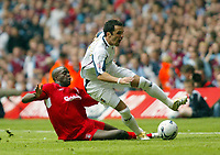 Photo: Chris Ratcliffe.<br />Liverpool v West Ham United. The FA Cup Final. 13/05/2006.<br />Mohamed Sissoko of West Ham tussles with Matthew Etherington of Liverpool.