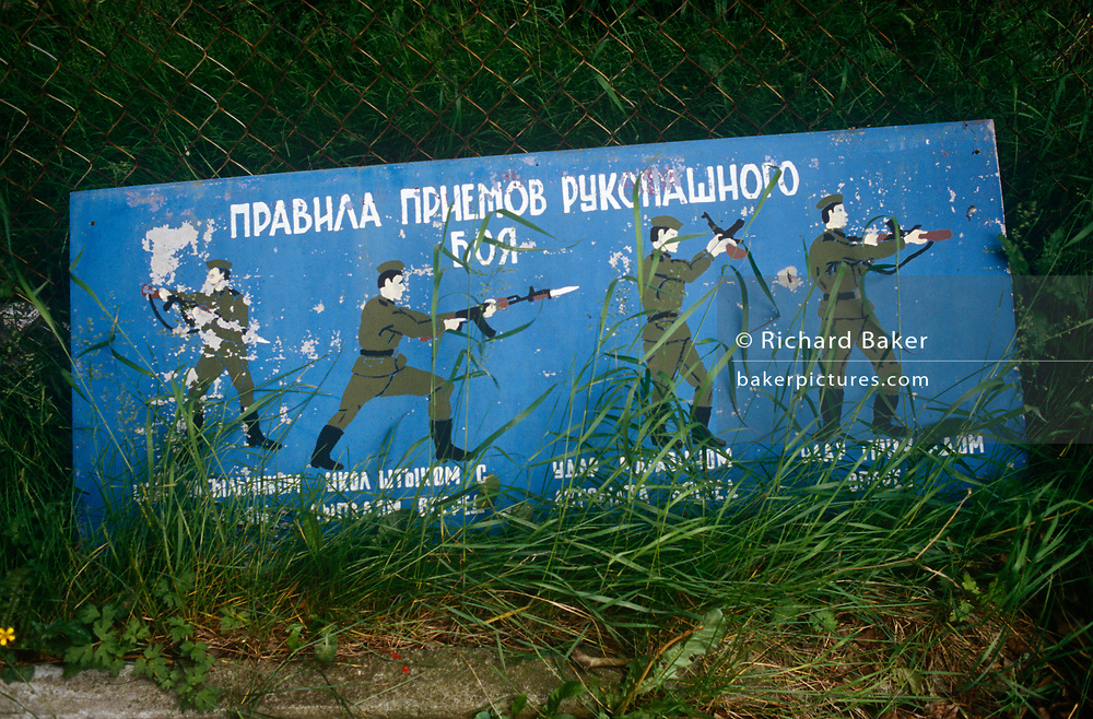 Old Soviet parade ground illustrations show self-defence positions for Russian soldiers in the former Russian army camp in occupied East Germany (ex-GDR/DDR), on 16th June 19990, on Halb Insel Wustrow, near Rostock, Germany. Wustrow was once a WW2 German anti-aircraft artillery position then housing civilian refugees before the eventual Soviet occupation of the former DDR during the Cold War, up until 1990 and the fall of communism and the Berlin Wall. The camp was ransacked and all its assets stripped before its desertion that summer and is a reminder of a fallen ideology