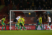 Sheffield United defender John Egan (12) wins a header in the West From box during the EFL Sky Bet Championship match between Sheffield United and West Bromwich Albion at Bramall Lane, Sheffield, England on 14 December 2018.