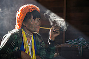 Cho Chin woman smoking, Mindat, Chin State, Myanmar
