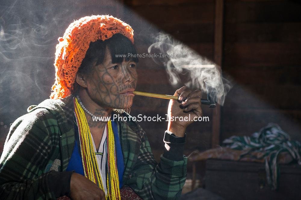 Cho Chin woman smoking, Mindat, Chin State, Myanmar