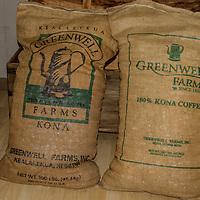 Burlap sacks of Greenwill Kona coffee beans ready to ship.
