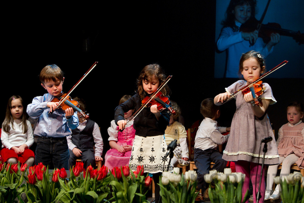 BRUSSELS - BELGIUM - 26 MARCH 2010 -- Children from the International Montessori School held a Violin, Piano and Guitar Concerts Thursday March 25 and Friday March 26 2010 in the Cultural Centre 'De Kam', Wezembeek-Oppem, just outside Brussels. PHOTO: ERIK LUNTANG / INSPIRIT Photo..