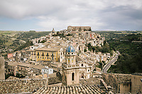 "RAGUSA, ITALY - 19 MARCH 2019: View of Ragusa Ibla in Ragusa, Italy, on March 19th 2019.<br /> <br /> The pietra pece (pitchstone) is a type of limestone which is charachterized by different percentages of bitumen.<br /> This morphologic origin makes the pietra pece particularly unique for its peculiar chromatic shading.<br /> In fact, the pietra pece is also called ""asphaltic stone"" because it has a colour that varies from gray to dark brown.    <br /> The company DESCAT has been the owner of the registered trademark of the pietra pece since 2014 and it has the ownership of the only extractive pietra pece quarry situated in the Tabuna/Cortolillo district in Ragusa, Sicily. The pietra is distributed by Artigianato Industriale."