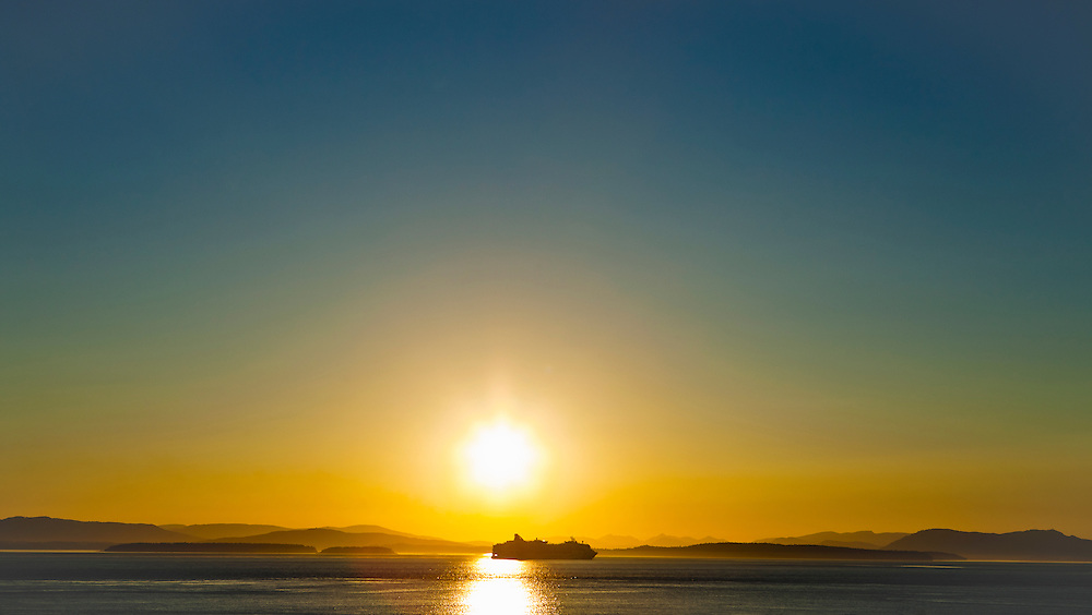 Cruise ship on the Haro Strait between Washington State and Vancouver Island, British Columbia at sunset.