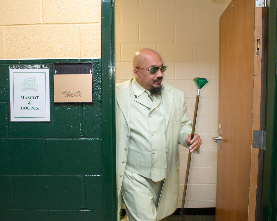 December 5, 2015 - Fairfax, VA - A day in the life of &quot;Doc Nix,&quot; aka Dr. Michael Nickens, the Director of the Athletic Bands for George Mason University. Doc Nix heads out of his dressing room for the performance.<br /> <br /> Photo by Susana Raab