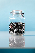 preserve jar with glass pebbles