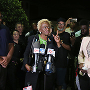 District Commissioner Regina Hill preaches during a vigil to honor her friend, deceased Orlando Police officer Master Sgt. Debra Clayton, who was shot and killed as she attempted to stop and question accused gunman Markeith Loyd, at an Orlando Walmart, on January 10, 2017 in Orlando, Florida. Orange County deputy Norm Lewis who was also killed on his motor patrol while responding to Clayton's shooting was also honored.  (Alex Menendez via AP)