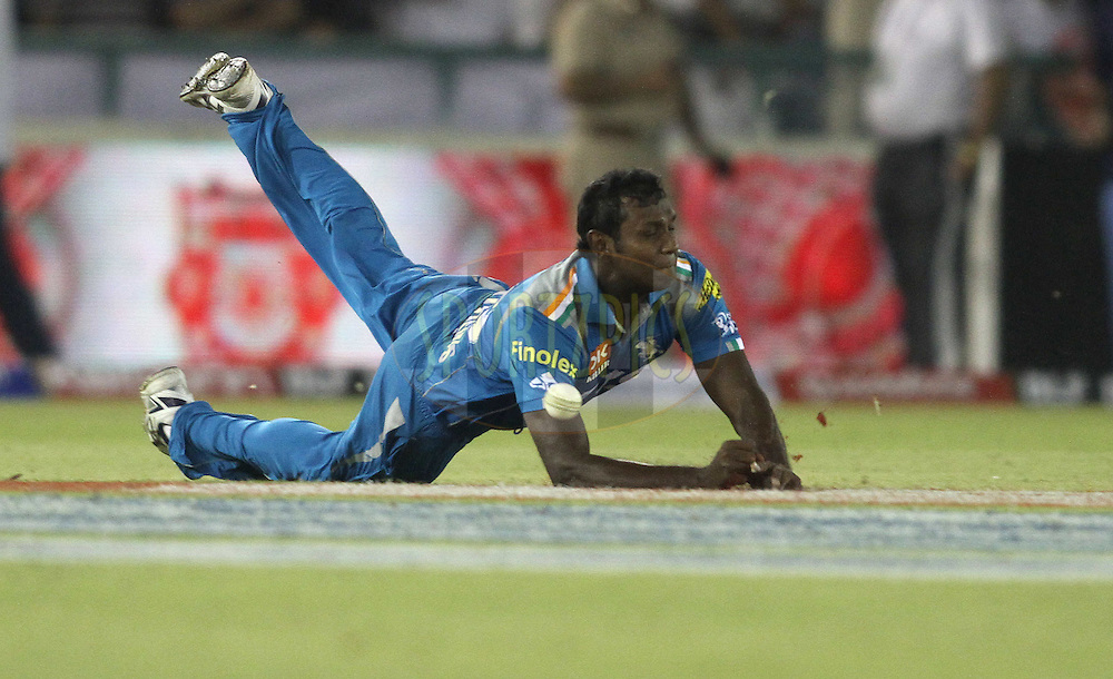Angelo Mathews of Pune Warriors India dives but is unable to hang onto the catch during match 14 of the the Indian Premier League ( IPL) 2012  between The Kings X1 Punjab and The Pune Warriors India held at the Punjab Cricket Association Stadium, Mohali on the 12th April 2012..Photo by Shaun Roy/IPL/SPORTZPICS