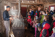 Molly and a crowd of Mass Audubon members learn all about maple syrup. Yummy!