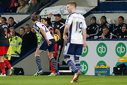 Craig Dawson of West Brom (2L) struggles to get the ball off Jefferson Montero of Swansea City as West Brom Manager Tony Pulis looks angered  - Photo mandatory by-line: Rogan Thomson/JMP - 07966 386802 - 11/02/2015 - SPORT - FOOTBALL - West Bromwich, England - The Hawthorns - West Bromwich Albion v Swansea City - Barclays Premier League.