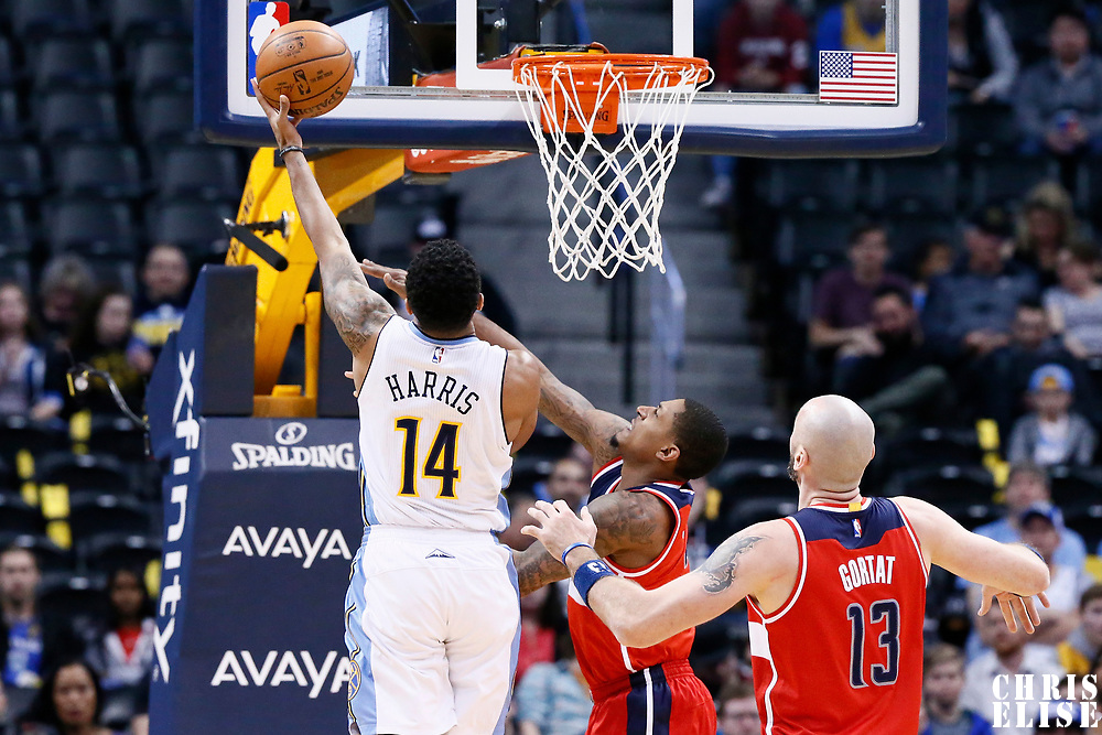 08 March 2017: Denver Nuggets guard Gary Harris (14) goes for the layup against Washington Wizards guard Bradley Beal (3) during the Washington Wizards 123-113 victory over the Denver Nuggets, at the Pepsi Center, Denver, Colorado, USA.