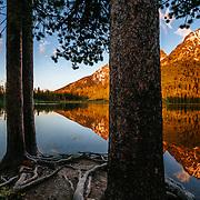 Grand Teton and the Teton Range Reflected in String Lake at sunrise near Jackson, Wyoming.