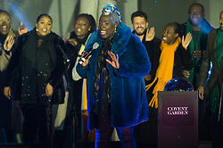 © Licensed to London News Pictures. 13/11/2018. London, UK. Choral Conductor KAREN GIBSON and The KINGDOM CHOIR perform before turning on the lights of Covent Garden Market Christmas lights. Photo credit: Ray Tang/LNP