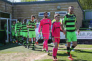 Forest Green Rovers Liam Noble(15) leads the teams out during the Vanarama National League Play Off second leg match between Forest Green Rovers and Dagenham and Redbridge at the New Lawn, Forest Green, United Kingdom on 7 May 2017. Photo by Shane Healey.