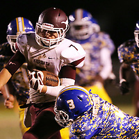 Lauren Wood   Buy at photos.djournal.com<br /> Kossuth's Charlie Bonee runs the ball while Booneville's Jarius Crump reaches for the tackle during Friday night's game at Booneville.