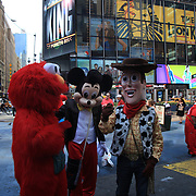 Entertainers dressed as cartoon characters in Time Square, New York. Times Squares' costumed entrepreneurs are officially free to ply their trade without fear of retribution.  The entertainers are allowed to receive tips, but not charge for pictures taken with them in costume. Times Square is the major commercial intersection in Midtown Manhattan. Time Square, New York, USA. 27th April 2012. Photo Tim Clayton