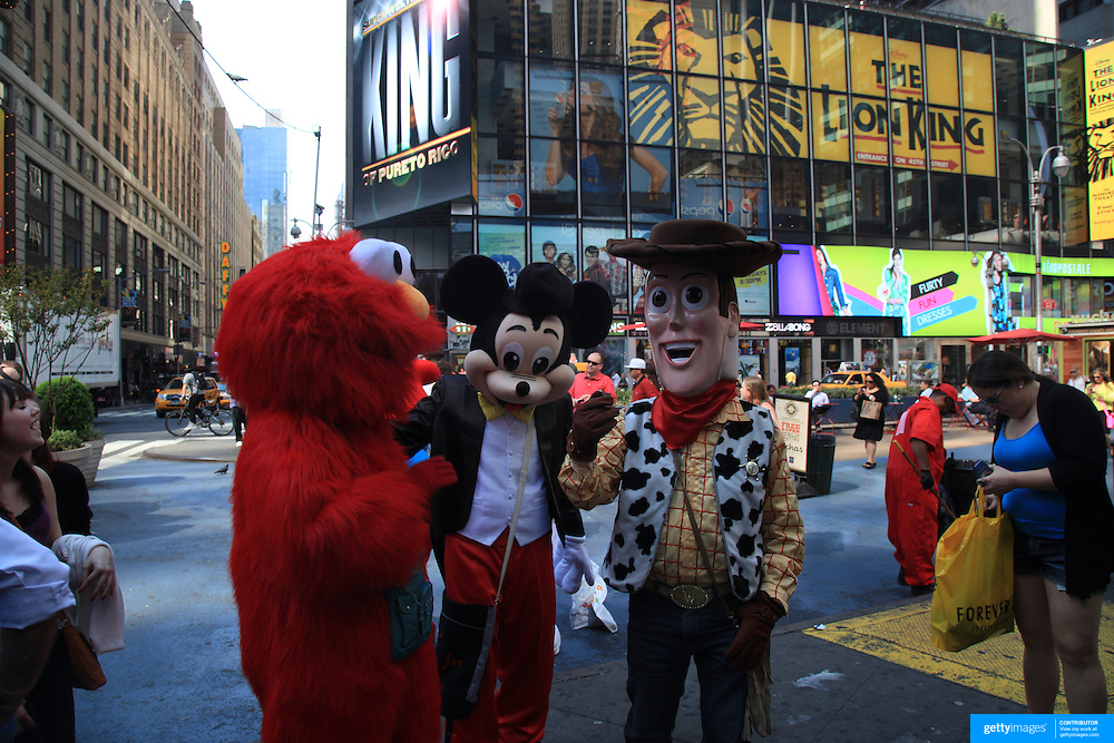 entertainers dressed as cartoon characters in time square new york