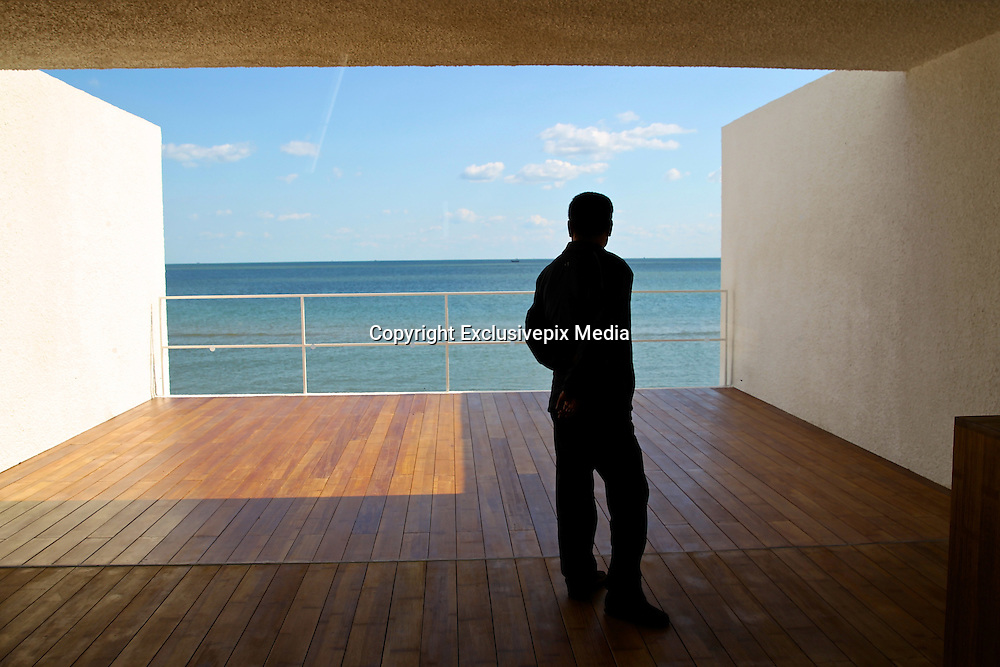 QINHUANGDAO, CHINA - OCTOBER 24: (CHINA OUT)<br /> <br />  A man stands in the  Aranya Community Hall on the beach at Beidaihe New District on in Qinhuangdao, Hebei Province of China.<br /> ©Exclusivepix Media