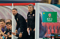 NANNING, CHINA - Thursday, March 22, 2018: Wales' new manager Ryan Giggs and assistant coach Osian Roberts during the opening match of the 2018 Gree China Cup International Football Championship between China and Wales at the Guangxi Sports Centre. (Pic by David Rawcliffe/Propaganda)