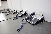 Landline telephones on desk in television station