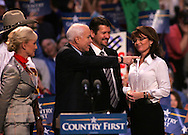 Senator John McCain and Governor Sarah Palin at a campaign rally in Virginia Beach, VA on October 13, 2008.  Photograph by Dennis Brack.left to right Hank Williams Jr. Cindy McCain, Senator McCain, Todd Palin, Sarah Palin