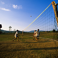 Boys play Takraw (kick volleyball), Luang Phrabang, Laos