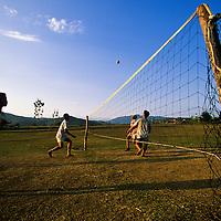 Boys play Takraw (kick volleyball), Luang Phrabang, Laos