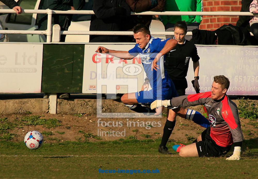 Johathon Hedge (GK) of North Ferriby United A.F.C. slides in on Jake Reed of Lowestoft Town and brings him down during the Conference North match at Grange Lane, North Ferriby<br /> Picture by Richard Gould/Focus Images Ltd +44 7855 403186<br /> 07/03/2015