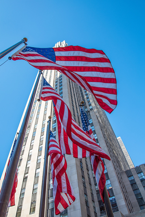 US flags fly in front of The Rockefeller Building