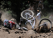 Ryan Sullivan crashes near the finish line during the Downhill Mountain Bike Race event at Northstar-at-Tahoe Resort in Truckee, Calif., on Sunday, July 26, 2009.<br /> (AP Photo/Kevin Clifford).