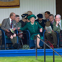 The Queen and the Duke of Edinburgh were today enjoying the Highland Games..The Monarch and Philip were greeted by a 17,000-strong crowd at the Braemar Gathering in Aberdeenshire..The Queen, who was dressed in emerald green, and a kilted Philip arrived at the Games' arena shortly after 3pm in a maroon Rolls-Royce..Spectators joined in singing the national anthem shortly after their arrival..The Queen received a posy from 11-year-old William Marsden before she and the Duke took their seats in the Royal Pavilion..The Queen is patron of the gathering, which takes place in the picturesque village of Braemar on the first Saturday in September and coincides with the Queen's annual two-month holiday at nearby Balmoral Castle.