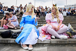 © Licensed to London News Pictures. 28/05/2017. London, UK.  Costumed characters take a rest at MCM Comic Con taking place at Excel in East London.  The three day event celebrates popular comic books, anime, games, television and movies.  Many attendees take the opportunity to dress as their favourite characters.    Photo credit : Stephen Chung/LNP