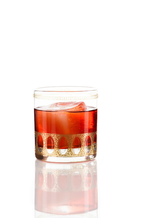 The Negroni, made with gin and Compari is traditionally served neat, but for those who prefer it on the rocks, this drink can be built over ice in a rocks glass.