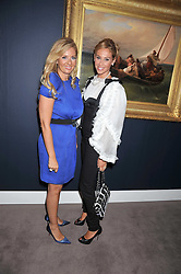 Left to right, ELENA MAKRI LIBERIS and NATASHA LIAKOUNAKOS at a party to celebrate the publication of Elena Makri Liberis's book 'Every Month, Same day' held at Sotheby's, 34-35 New Bond Street, London on 5th May 2009.