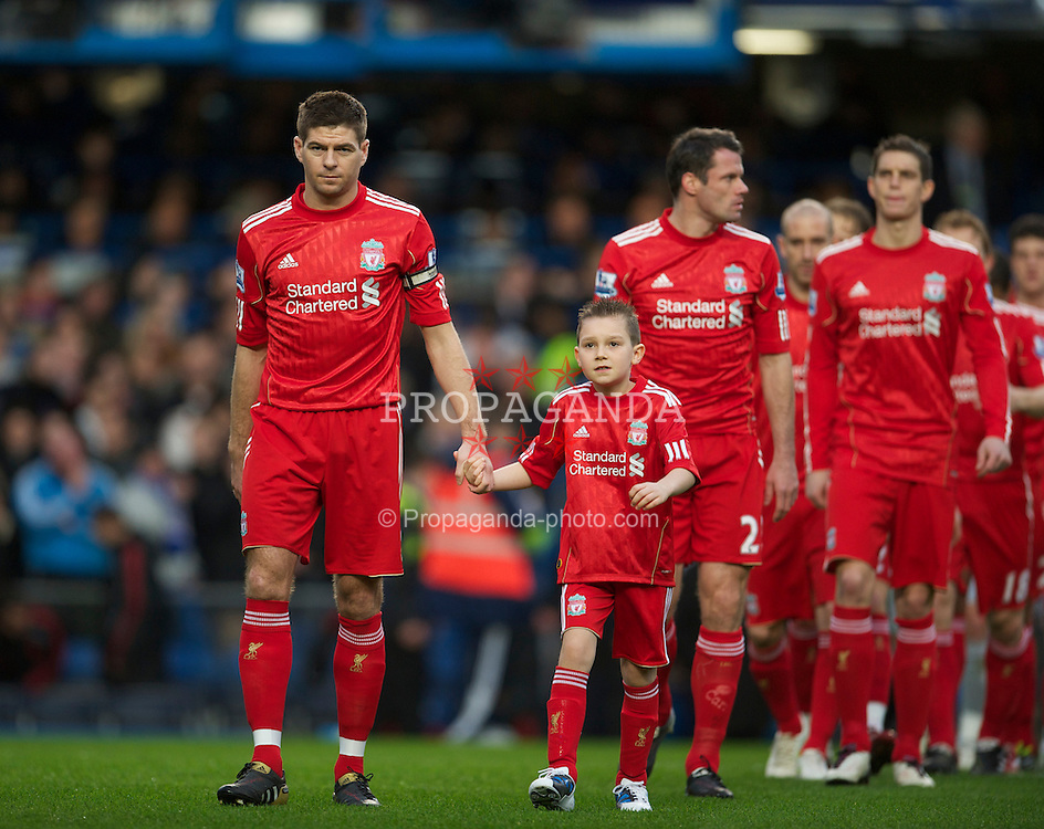 LONDON, ENGLAND - Sunday, February 6, 2011: Liverpool's captain Steven Gerrard MBE leads his side out to face Chelsea during the Premiership match at Stamford Bridge. (Photo by David Rawcliffe/Propaganda)