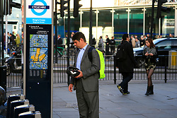 Commuter looks at the map on cycle hire docking station. © under license to London News Pictures. 01/11/2010.Tube Strike, RMT and TSSA members strike over job cuts and safety issues.