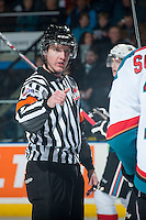 KELOWNA, CANADA - JANUARY 7: Referee Mike Campbell stands on the ice and makes a call on January 7, 2015 at Prospera Place in Kelowna, British Columbia, Canada.  (Photo by Marissa Baecker/Shoot the Breeze)  *** Local Caption *** Mike Campbell;