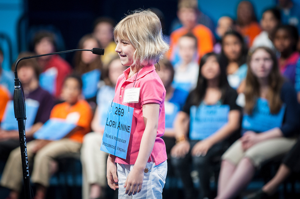 LORI ANNE C. MADISON, 6, of Woodbridge, VA, competes in round two of the 85th Annual Scripps National Spelling Bee at the Gaylord National Resort & Convention Center in National Harbor, Md., near Washington, D.C. Madison is the youngest ever participant in the National Spelling Bee.