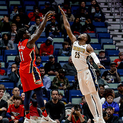 Dec 6, 2017; New Orleans, LA, USA; New Orleans Pelicans guard Jrue Holiday (11) shoots over Denver Nuggets guard Malik Beasley (25) during the first quarter at the Smoothie King Center. Mandatory Credit: Derick E. Hingle-USA TODAY Sports