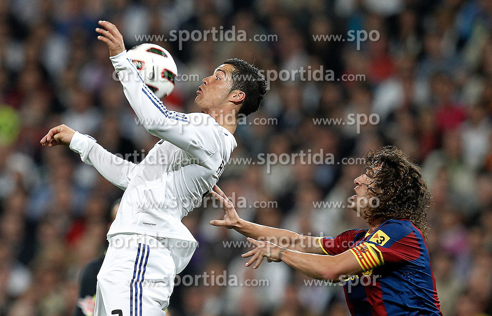 16.04.2011, Estadio Santiago Bernabéu, ESP, La Liga, Real Madrid vs FC Barcelona, im Bild Real Madrid's Cristiano Ronaldo and FC Barcelona's Carles Puyol  during la Liga match on April 16th 2011, EXPA Pictures © 2010, PhotoCredit: EXPA/ Alterphotos/ ALFAQUI/ Cesar Cebolla