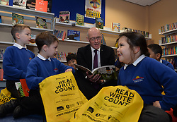 Pictured: John Swinney<br /> <br /> Deputy First Minister John Swinney celebrated Book Week Scotland today as he visited Forthview Primary School in Edinburgh. The minister visited the school library to see Primary 2 pupils exploring their new Read, Write, Count gift bags. The scheme was launched by the Scottish Government in 2015 to give support to parents and carers to help them get involved in their child's learning<br /> <br /> Dave Johnston | EEm 29 November 2017