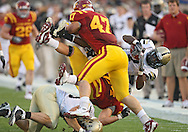 September 26, 2009: Army's Damion Hunter (7) is hit by Iowa State linebacker Derec Schmidgall (24) and Iowa State linebacker A.J. Klein (47) during the first half of the Iowa State Cyclones' 31-10 win over the Army Black Knights at Jack Trice Stadium in Ames, Iowa on September 26, 2009.