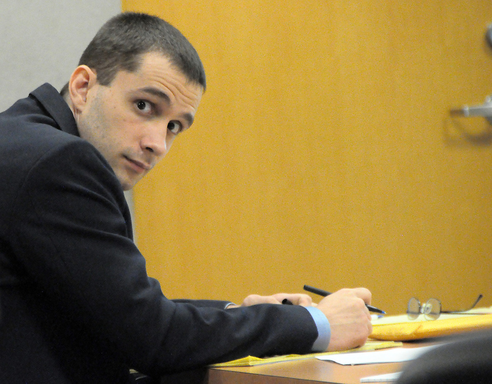Andrew Knapp, FLORIDA TODAY -- Oct. 14, 2011 -- Christopher Eddy jots down notes during the prosecution's closing arguments Friday morning in the trial in which he's charged with attempted murder in the shooting of state wildlife Officer Vann Streety.