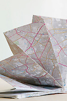 Map folded in fan shape studio shot