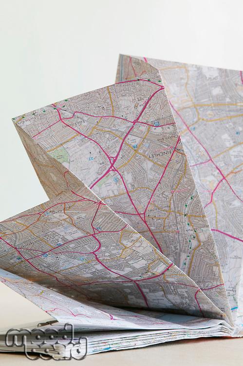 Map folded in fan shape studio shot