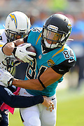 Jacksonville Jaguars wide receiver Cecil Shorts (84) is tackled by San Diego Chargers cornerback Johnny Patrick (26) during an NFL game at EverBank Field on Oct. 20, 2013 in Jacksonville, Florida. San Diego won 24-6.<br /> <br /> ©2013 Scott A. Miller